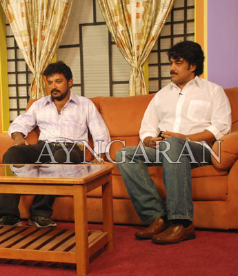 Sundar C and director Badri in DD Podhigai