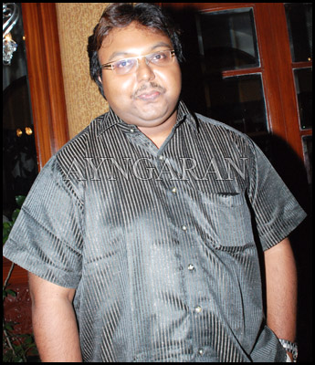 Composer Imman has his hands full