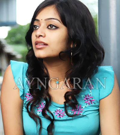 Janani Iyer busy in Gods own country