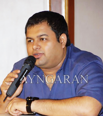 Thaman busy in both languages